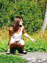 16 pictures - Voyeur busts a gorgeous leggy college girl peeing