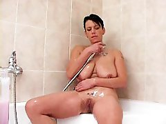 4 movies - Sexy busty brunette relieves herself in the bath
