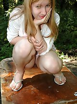 16 pictures - Prankish babe pisses onto a table in the park